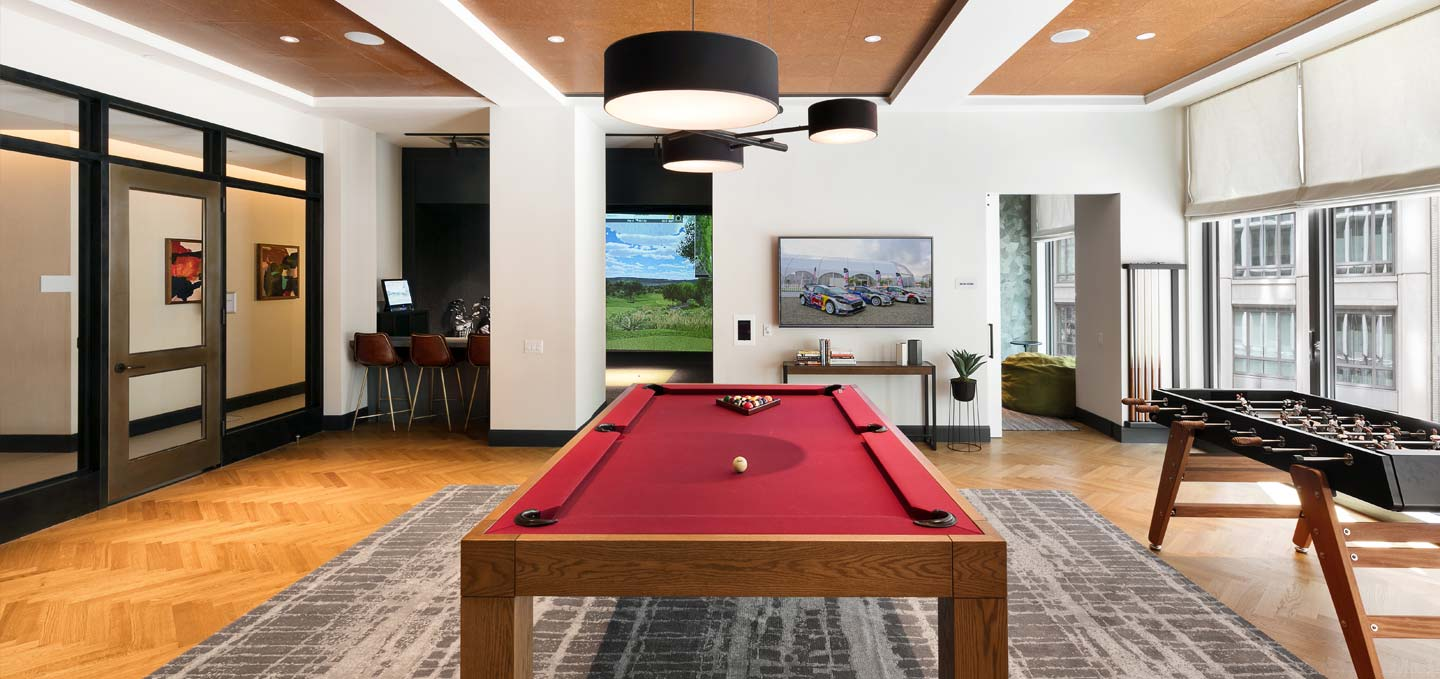 gaming room including foosball, billiard table, and virtual golf